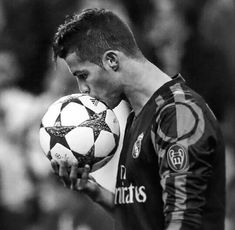 Ronaldo kissing a soccer ball.