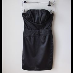 """White House Black Market strapless dress Black satin strapless dress - inner silicone band for support - back zipper with hook and eye closure - boning at front bust - back slit at hemline - like new! - polyester/spandex - lined- chest across measures 15"""" - total length measures 30"""" - size 0 White House Black Market Dresses"""