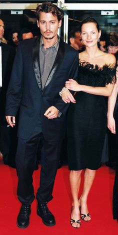 At the 1998 Cannes Film Festival. This suit is fairly classic, but he adds his grunge style with combat boots.