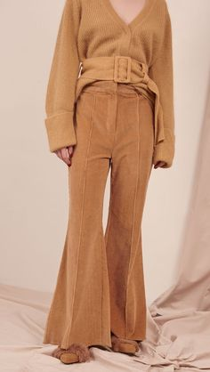 The Myla corduroy pant in caramel. No pockets, flare-cut hem, back slits, back vent, hook and zip fly closure. High rise. COMPOSITION AND CARE Hand wash cool / Wash separately Please treat with care t