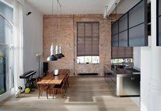 Brick wall, vintage&design furniture for this loft in Amsterdam / Muro di mattoni a vista e mobili vintage&design per questo loft ad Amsterdam