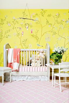 Chinoiserie wallpaper in bright lemon yellow, cute bird mobile, and skirted crib? This one's fit for a modern-day little princess!
