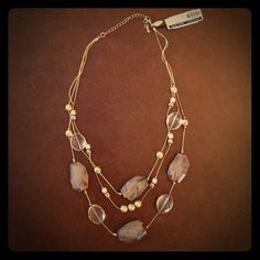 """Tan Stone Necklace w/ 3 tiers Brand new gold necklace with gold & tan beads. Has 3 tiers. Measures 12"""" in length. Clasp closure. NY&Co Jewelry Necklaces"""