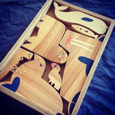 Wooden box containing a set of Arctic animal toys: a walrus, a beluga whale, a polar bear, a stellar sea lion, a sea otter, a puffin, plus a fish for them to fight over. Simple wooden toys work as blocks or as toys for narrative play, while teaching child…