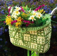Celebrate summer with this sweet bike basket, from Knitting Today! Magazine. It's made in two-color basket weave and is sturdy enough to hold your lighter cargo. Perfect for rides to the beach or farmer's market!    Download the free bicycle basket knitting pattern here:  http://www.craftster.org/blog/wp-content/uploads/2011/06/KnittingToday_BikeBasket_FreePattern.pdf #diy #knitting #crafts #bike_basket #basket
