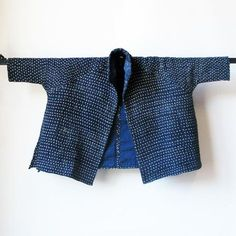 "Hand woven indigo cotton swing coat by Neeru Kumar. Hand died indigo with Kantha stitching. Dimensions: Bust: 72"" Length: 29"""