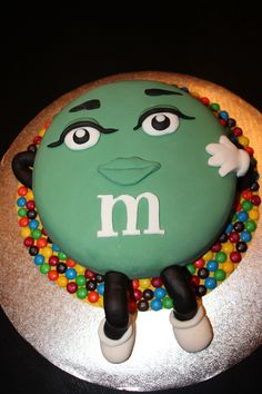m&m - 10 inch chocolate cake with buttercream frosting &  covered in fondant.
