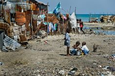 Haitian children play in the slum of Cité Soleil, Port-au-Prince, Haiti, 11 July 2008. Cité Soleil is considered one of the worst slums in the Americas