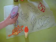 Glue leaves on wax paper