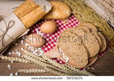 Slices of bread with  eggs,rye and French Baguette on a wooden background.