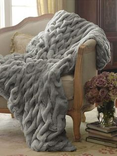 Paris Faux Fur Throw Lush, plush and soft beyond imagining, our exclusive and elegant Faux Fur Throw is a chic statement just for you! Artisan stitching creates an opulent tex