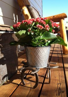 Recycled horseshoes made into a plant stand by Can-D-Lite.com