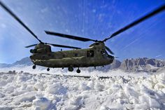A CH-47 Chinook helicopter raises a white out of blowing snow as it lands at a remote landing zone in Shah Joy district, Zabul province, Afghanistan, Feb. 8. Helicopters provide an efficient and reliable means of transporting personnel and cargo to rural areas of Afghanistan.     For more information about Chinooks, visit: http://www.army.mil/factfiles/equipment/aircraft/chinook.html.  #ArmyAviation