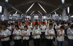 Volunteer rescue workers and religious organizations pray during multi-religion mass prayers for the passengers of Malaysian Airlines flight MH370, at the Kuala Lumpur International Airport in Sepang March 9, 2014. Reuters/Edgar Su