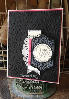 "Stamp set: Chalk Talk   Cardstock: Basic Black, Strawberry Slush, Very Vanilla   Ink:  Smoky Slate, Whisper White Craft Ink Accessories:  Tea Doily, Rhinestones, Chalk Talk Framelits, 1 3/8"" Circle Punch, Beautifully Baroque Embossing Folder, Strawberry Slush Ruffle Ribbon, Modern Medley DSP"