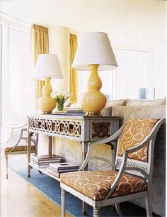 House Beautiful: Yellow & gray living room design with gray wood console sofa table, yellow gold gourd ...