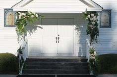 Southern Church Wedding:  A little something different for the outside of the church.  Swags of fresh cut greenery, pink hydrangeas and garden roses welcomed guests as they entered the church.
