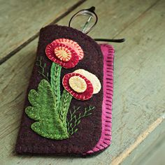 Folk Art Glasses Case              This simple sewing project will make the perfect gift. Applique pretty wool felt blossoms onto this handmade glasses case using our free patterns