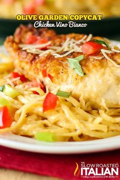 Copycat Olive Garden Chicken Parmesano Vino Bianco recipe with a creamy Parmesan white wine cream sauce so delicious it may transport you to Italy.