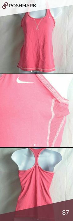 Small Pink Nike Dri-Fit Racerback Tank Top This is a very nice tank top from Nike, that is from thier Dri-Fit collection.  It is solid pink with the white Nike logo on the top of the front, as well as white stitching on the trim.  This tank top has a built in bra, and is made with soft, stretchy material for a perfectly comfortable fit.  There are no flaws with this top, and it is size small. #nike #nikedrifit #drifit #athletic #tanktop #racerback #pink #sizesmall Nike Tops Tank Tops