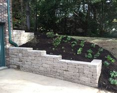 51 Really Cool Retaining Wall Ideas Sebring Design Build Design Trends Inexpensive Retaining Wall Ideas, Cheap Retaining Wall, Building A Retaining Wall, Concrete Retaining Walls, Stone Retaining Wall, Landscaping Retaining Walls, Farmhouse Landscaping, Home Landscaping, Retaining Wall Design