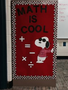 MATH IS COOL! To display the symbols commonly used in Math, the side of a file cabinet came in handy and, so did Joe Cool, for this second grade classroom.