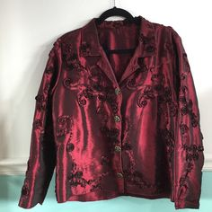 Winding Rivers beautiful evening wear too Winding a Rivers beautiful dark satiny blouse with flower designs. Perfect dressy evening wear top in dark, shimmery maroon or burgundy. Excellent condition. Size Large Winding Rivers Tops Blouses