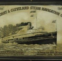 """Image of  Artifact Frame etched tin advertising sign for the Detroit and Cleveland Steam Navigation Company featuring an image of the passenger steamer CITY OF ALPENA. Gold text at the bottom advertises, """"Daily Between Detroit and Cleveland, Daily Between Cleveland and Put-In-Bay, 4 Trips Per Week Detroit and Mackinac."""" 1893"""