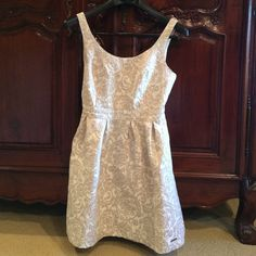 Size 6 Abercrombie & Fitch Cream Color Dress. Size 6, Abercrombie & Fitch Cream Color Dress. In Excellent Condition. No issues. Hint of Sparkling Gold Color over the decor. Fully Lined Dress. Measures 32 inches from the top of the shoulder to the bottom.  Abercrombie & Fitch Dresses