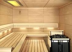 Small Sauna Room Interior Design Ideas With L Shape Bench Also Modern Coal Heat Machine Plus Recessed Lighting Sauna Steam Room, Sauna Room, Modern Saunas, Best Paint For Kitchen, Sauna Kits, Indoor Sauna, Add A Room, Sauna Design, Finnish Sauna