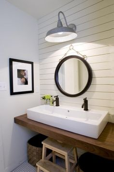 What do you think of this country bathroom? The vessel sink adds a modern flare to this natural beauty.