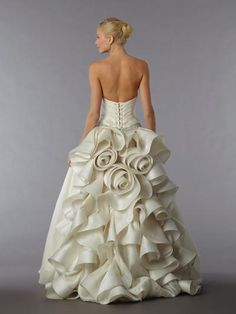 Pnina tornai, wedding dress, rose accents with a romantic feel. Beautiful. But not every woman can pull this off.