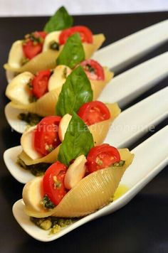 Spoonful caprese salad in pasta shell