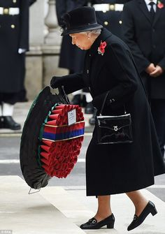 The Queen lays a wreath at the Cenotaph, followed by other members of the Royal Family, party leaders and Commonwealth representatives