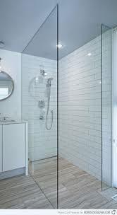 walk in shower, simple glass screen  tub next to it all tied in together with subway tile and glass
