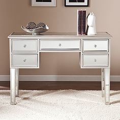 The glamorous Mirage Mirrored 5-Drawer Console Table from Southern Enterprises will accent any home decor. With its mirrored finish, it adapts to any surrounding and catches your eye with its unique presence. Includes 5 drawers with faux crystal knobs.