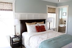 Pretty wall color with the moulding behind the bed. Nice clean white bedding.- Wall color Luna Light by Columbia Paints, can be color matched at Sherwin Williams