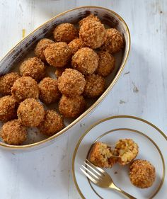 This tiny twist on classic Italian arancini is totally irresistible. Long grain rice yields a lighter, fluffier rice ball than traditional Arborio and a little egg is all it takes to keep it together. If you'd like to get a leg up on prep, the bites can be rolled, breaded, and kept refrigerated in the pan overnight prior to baking.