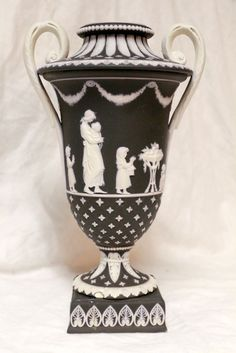Circa 1800 Wedgwood Black Jasperware Dip Ornate Handled Urn Vase.Missing lid. Wedgwood only. 8 inches by 4 5/8 inches.