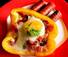 Bell Pepper Egg Nest - Baked eggs on top of fried sausages with onions and tomatoes in juicy bell peppers.