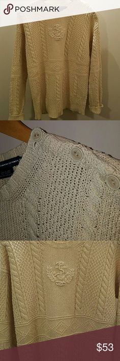 RL Cream anchor sweater One of the most beautiful sweaters I've seen from Ralph. The knitting is so detailed, along with the ship buttons on the shoulder.  Great condition, no pills or pulls in the fabric.  Fits a little bigger than a M Ralph Lauren Sweaters