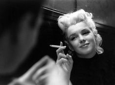 Deep in conversation with Redbook editor Robert Stein at Costello's. | 31 Candid Photos Of Marilyn Monroe In New York