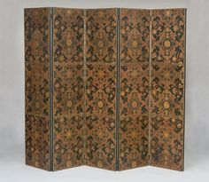 CONTINENTAL PAINTED AND PARCEL-GILT EMBOSSED LEATHER FIVE-PANEL SCREEN, POSSIBLY SPANISH