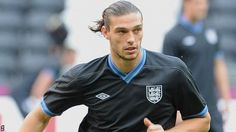 Liverpool forward Andy Carroll is set to start up front tonight against Sweden.