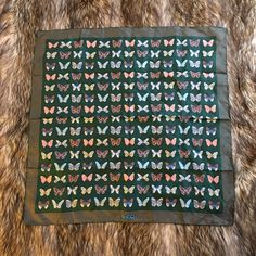 """Vintage Gucci Butterfly Silk Scarf Vintage 1970s GUCCI ITALY 100% Silk butterfly printed scarf. Gorgeous Dark Forrest Green background with detailed, multi-color butterfly artwork. Striped border with prominent logo at bottom center. Made in Italy, as labeled. Virtually unused, with no signs of use. In 'like new' condition. Measurements: 27"""" X 27"""" Gucci Accessories Scarves & Wraps"""