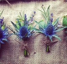 Thistle is a great choice for boutonnieres and *should* hold up for the day!