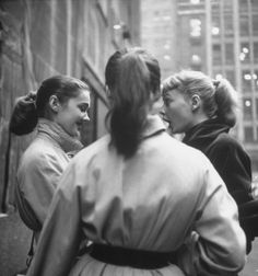 Trench coats and ponytails in 50's America.  Photo by Martha Holmes