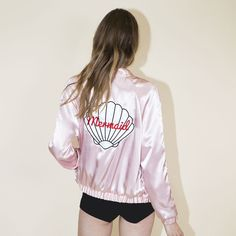 Channelyour inner mermaid✨❤️  This baby pink colored, long sleeve bomber jacket features a white shell on the back, side pockets, elasticwaist and wri...
