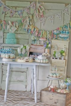 Love, love, love the vintage fabric bunting, and banners going on here - The mix of styles and the way they are overlapping on the vintage doors - so pretty! #wedding #babyshower