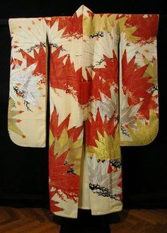 Furisode, Taisho period (1912–26), c. 1920    Silk, plain weave with creped weft (chirimen); resist dyed (yuzen-zome); stamped gold and silver leaf over adhesive (inkin); embroidered with silk, rayon and gold-leaf-over-adhesive-on-paper-strip-wrapped rayon, rayon padded satin stitches;  Lined with silk, plain weave  132.7 x 181.3 cm (52 1/4 x 71 3/8 in.).  The Art Institute of Chicago